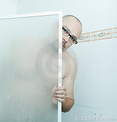 Man in glasses under shower