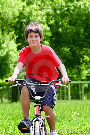 Teenager boy with bicycles
