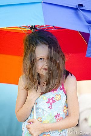 Little girl and umbrella