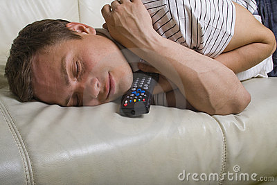 Man falling asleep with TV remote control