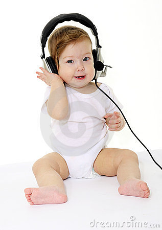 Happy singing baby with black headphones
