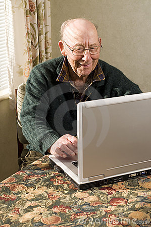 Senior man on laptop