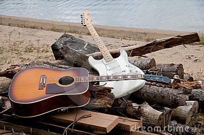 Two guitars on the beach