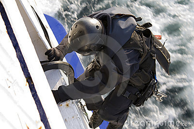 Special Forces Agent Climbing into a Moving Ship