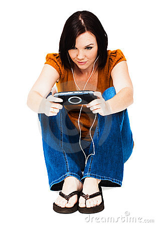 Young woman listening media player