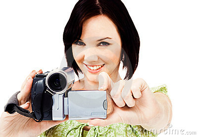 Portrait of woman holding home video camera
