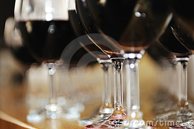 Many wine glasses in row