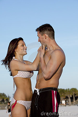 Sexy Man and Woman on Beach