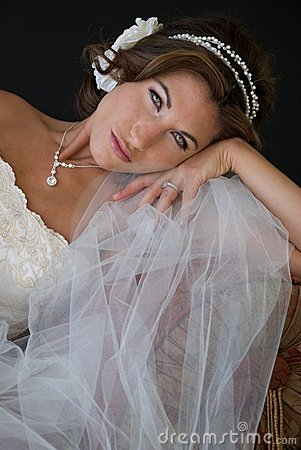 Bride Rests Head on Hand