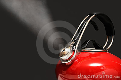 Red Kettle Boiling Isolated on Black
