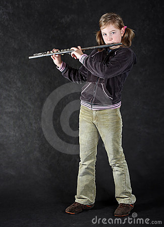 Attractive young girl flautist.