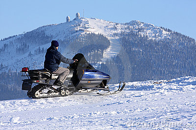 Woman on snowmobile