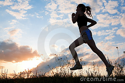 Silhouette woman run under blue sky