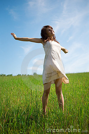 Woman in dress in field