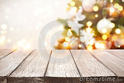 Christmas background. Wooden planks over blurred holiday tree lights