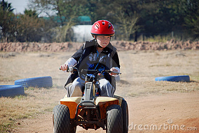 Young Boy riding a Quadbike