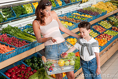Grocery store - Mother with child buying fruit