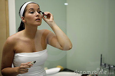 Young attractive woman getting ready in bathroom