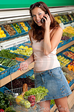 Grocery store - Smiling woman with mobile phone
