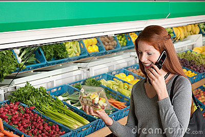 Grocery store - Red hair woman with mobile phone
