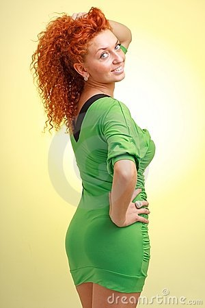 Red haired woman in little green dress