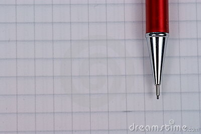 Page of notebook and red pencil