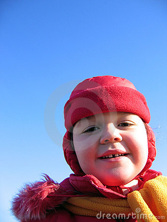 Girl in a red hat with ear flaps
