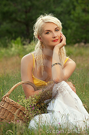 Girl relaxing on a meadow