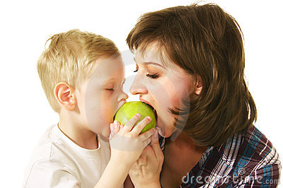 Mother and son eating apple