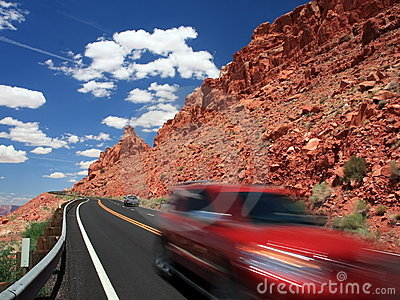 Red  car on the road in Arizona