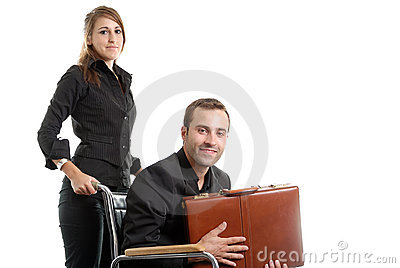 Woman pushing a disabled businessman in wheelchair