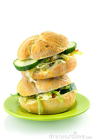 Stack of two fresh sandwiches on a green plate