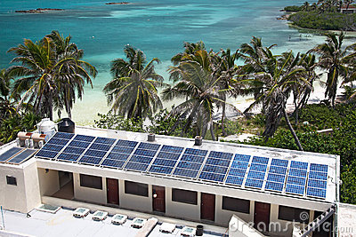 beach with a building with a solar panel on the I