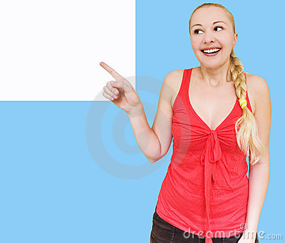 Smiling woman pointing towards copyspace
