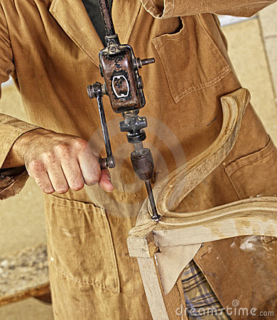 Carpenter with hand drill