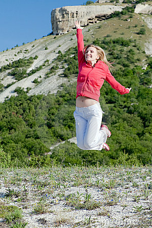 Jumping woman at the mountains