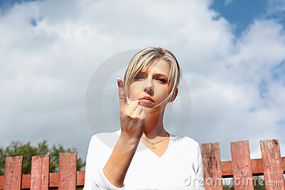 A pretty woman with pointing finger