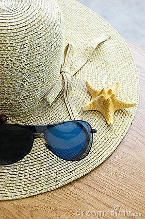 Hat, sunglasses and shells