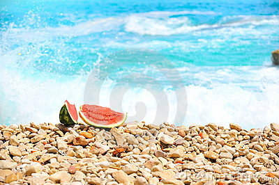 Slices of watermelon at seashore