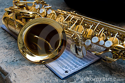 Saxophone closeup together with notes