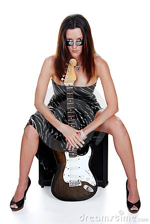 Attractive brunette holding a guitar