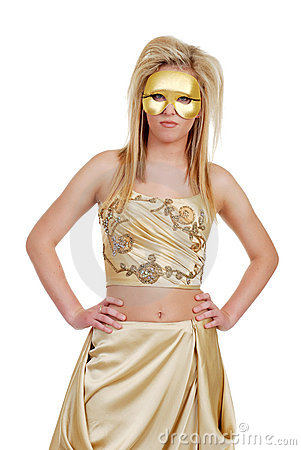 Blond woman in gold with hands on hips