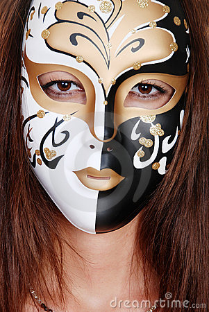 Closeup brunette wearing a gold white  black mask