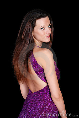 Seductive brunette wearing a purple dress