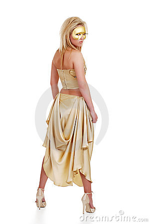 Young blond model with a golden dress