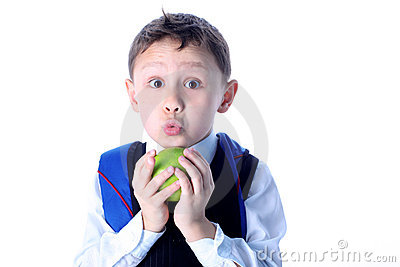Surprised schoolboy with apple