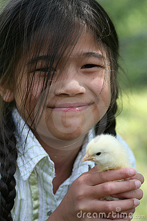 Little girl holding pet chick