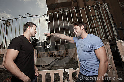 Man telling the other man to leave