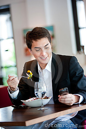 Man with Salad and Phone