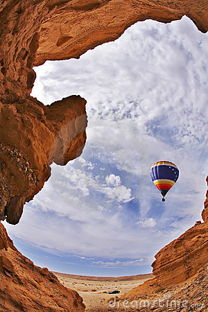 The balloon flies above a picturesque canyon